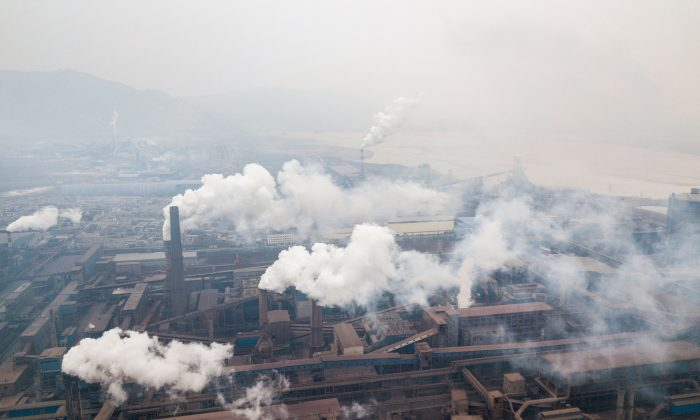 This aerial view taken with a drone shows pollution being emitted from steel factories in Hancheng, Shaanxi Province, China on Feb. 17, 2018. (Fred Dufour/AFP/Getty Images)
