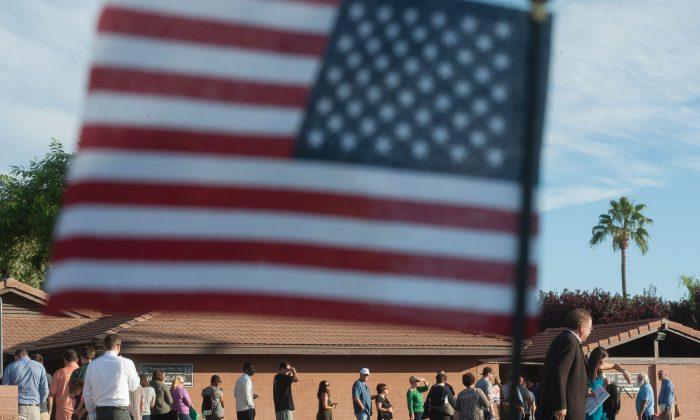 Voters wait in line in front of a polling station to cast their ballots in the U.S. presidential election in Scottsdale, Arizona on Nov. 8, 2016. (Laura Segall/AFP/Getty Images)