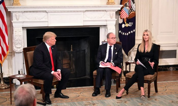 (L-R) US President Donald Trump, Director of the National Economic Council Larry Kudlow listen as Advisor to the President Ivanka Trump speaks at an event for American workers in the State Dining Room of the White House in Washington, DC on October 31, 2018. (Photo by Mandel NGAN / AFP)        (Photo credit should read MANDEL NGAN/AFP/Getty Images)