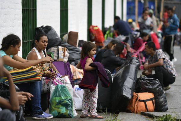Venezuelan migrant families at a makeshift camp alongside the Cali river.