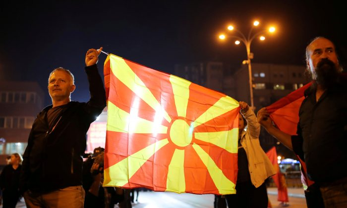 Protesters shout out slogans about boycotting the referendum on changing the country's name that would open the way for it to join NATO and the European Union in Skopje, Macedonia, on Sept. 30, 2018. (Reuters/Marko Djurica)