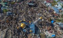 Scale of Indonesian Disaster Emerges but Rescuers Hold Hope for Survivors