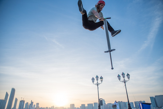 Mahoney performing a pogo trick in Abu Dhabi