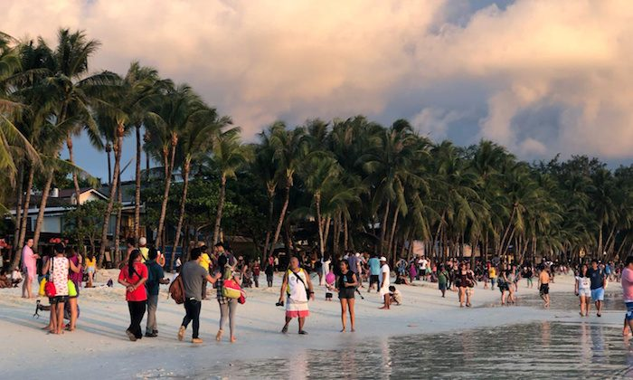 Tourists frolic during sunset in Boracay, Philippines Oct. 26, 2018. (Reuters/Ronn Bautista)