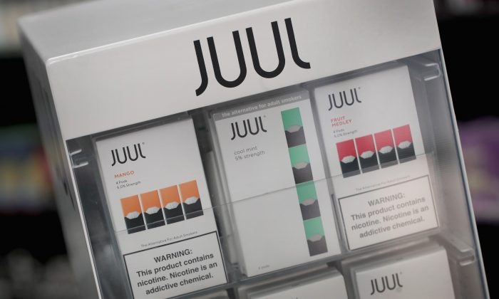 Electronic cigarettes and pods by Juul, the nation's largest maker of vaping products, are offered for sale at the Smoke Depot on September 13, 2018 in Chicago, Illinois. (Scott Olson/Getty Images)