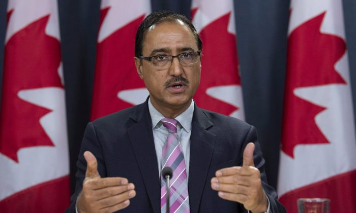 Natural Resources Minister Amarjeet Sohi speaks about the government's plan for the Trans Mountain Expansion Project during a news conference in Ottawa on Oct. 3, 2018. (The Canadian Press/Adrian Wyld)