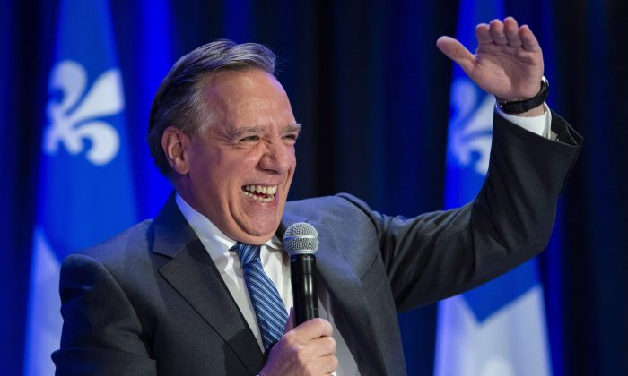 Quebec premier-designate Francois Legault smiles as he addresses a meeting of his new caucus and defeated candidates in Boucherville, Que. on Oct. 3, 2018. (The Canadian Press/Paul Chiasson)