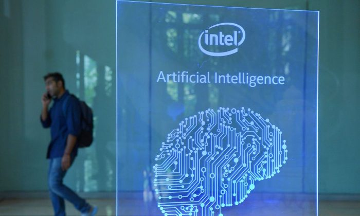A visitor at Intel's Artificial Intelligence (AI) Day walks past a signboard during the event in the Indian city of Bangalore on April 4, 2017. (MANJUNATH KIRAN/AFP/Getty Images)