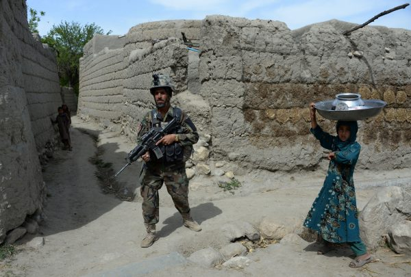 A member of the Afghan security forces patrols during an ongoing an operation against Islamic State.