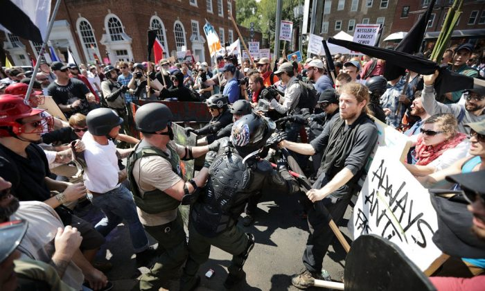 """Protesters clash with counter-protesters as they enter Emancipation Park during the """"Unite the Right"""" rally in Charlottesville, Va., on Aug. 12, 2017. (Chip Somodevilla/Getty Images)"""