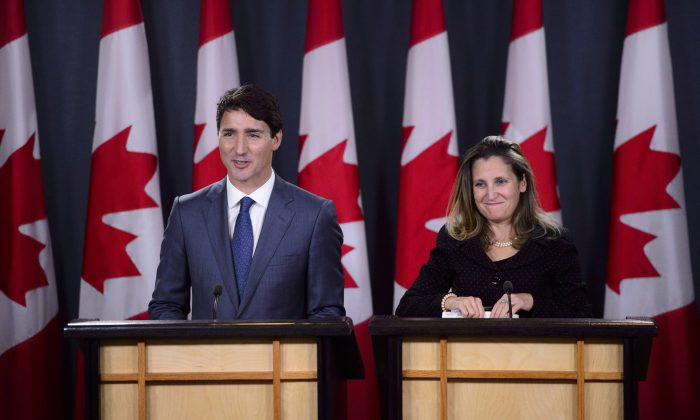Prime Minister Justin Trudeau and Minister of Foreign Affairs Chrystia Freeland hold a press conference regarding the United States Mexico Canada Agreement (USMCA) in Ottawa on Oct. 1, 2018. (The Canadian Press/Sean Kilpatrick)