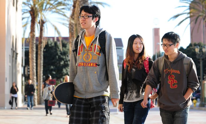USC students on their way to attend a memorial service on April 18, 2012 in Los Angeles, California (FREDERIC J. BROWN/AFP/Getty Images)