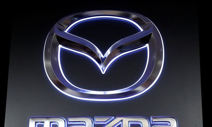 The logo of Mazda Motor Corp. is displayed at the company's news conference venue in Tokyo, Japan May 11, 2018. (Kim Kyung-Hoon/Reuters)