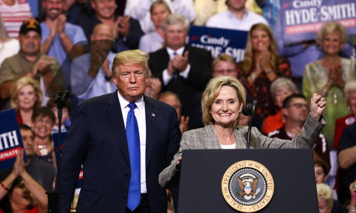 "President Donald Trump and Sen. Cindy Hyde-Smith (R-Miss.) at a Make America Great Again rally in Southaven, Miss., on Oct. 2, 2018. Hyde-Smith has caused a media storm over remarks she made about ""public hangings,"" with opponents accusing her of being racist. (Charlotte Cuthbertson/The Epoch Times)"