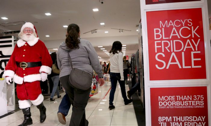 A Santa Claus walks with Black Friday shoppers inside a Macy's store at the Glendale Galleria in Glendale, California, on Nov. 29, 2013. (Jonathan Alcorn/Reuters)
