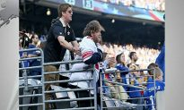 Saints Fan Helps Disabled Giants Fan Stand for National Anthem Before Game