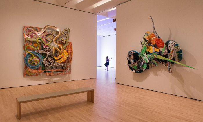 A woman takes a photo inside the San Francisco Museum of Modern Art (SFMOMA) in San Francisco, California, on April 28, 2016. 