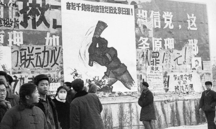 "A small group of Chinese youth walk past several dazibao, revolutionary placards, in February 1967 in downtown Beijing, during the ""Great Proletarian Cultural Revolution."" (JEAN VINCENT/AFP/Getty Images)"