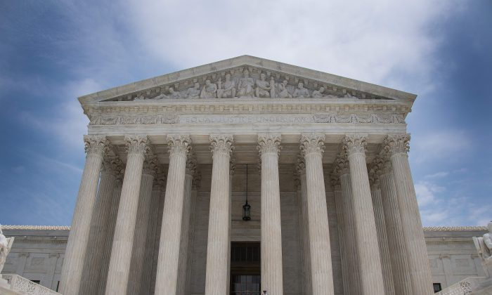 A police officer stands guard on the steps of the US Supreme Court in Washington, DC on June 15, 2017. (JIM WATSON/AFP/Getty Images)