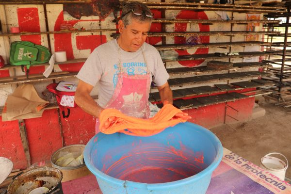 Chava Reyes at work making fuses for his fireworks products in Tultepec, Mexico.