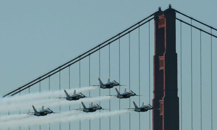 F/A-18 Hornets of the U.S. Navy Blue Angels fly by the Golden Gate Bridge as they practice their Fleet Week performance in San Francisco. San Francisco kicks off its annual Fleet Week celebration with the parade of ships and an air show featuring the Blue Angels. (Justin Sullivan/Getty Images)