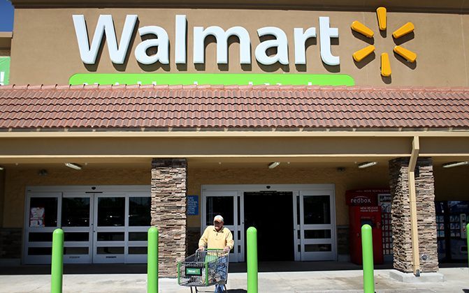 A Walmart customer exits from the store on Feb. 19, 2015 in Miami. (Joe Raedle/Getty Images)