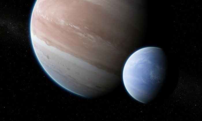 An artist's impression of the exoplanet Kepler-1625b, transiting the star, with the newly discovered exomoon in tow is shown in this image released on October 2, 2018. (Courtesy Dan Durda/Handout via Reuters)