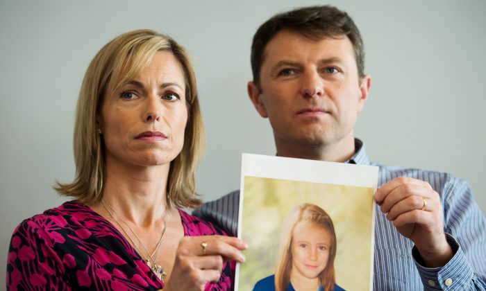 Kate and Gerry McCann pose with an artist's impression of how their daughter might look at the age of 9 in London on May 2, 2012. (AFP/Getty Images)