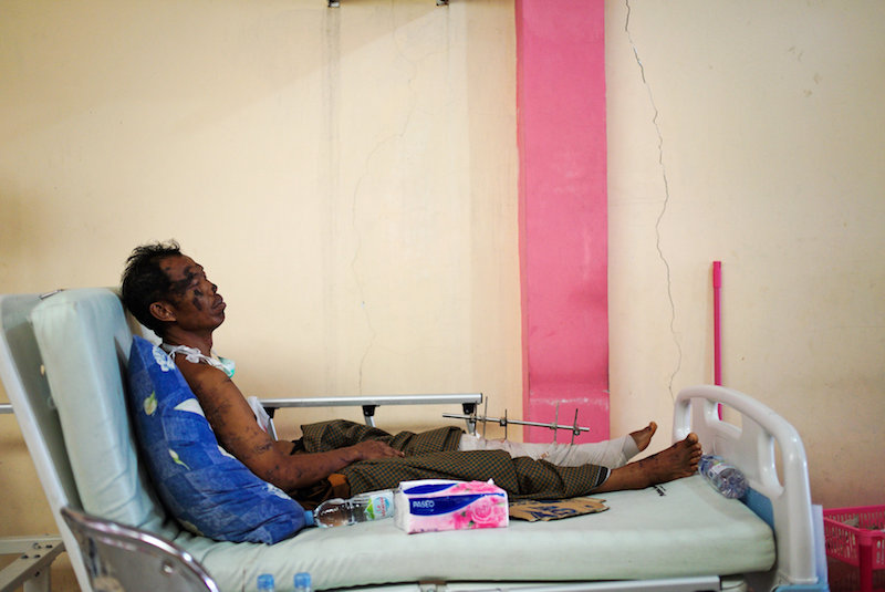 earthquake victom on hospital bed in sulawesi