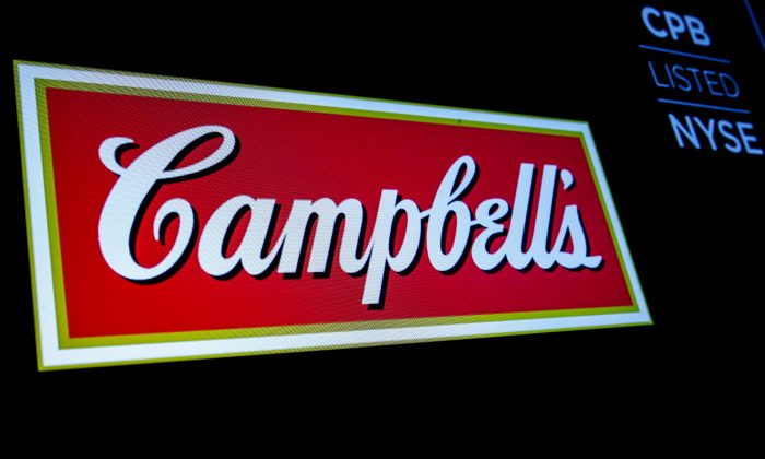 The logo and ticker for Campbell Soup Co. are displayed on a screen on the floor of the New York Stock Exchange on May 18, 2018. (Reuters/Brendan McDermid/File Photo)