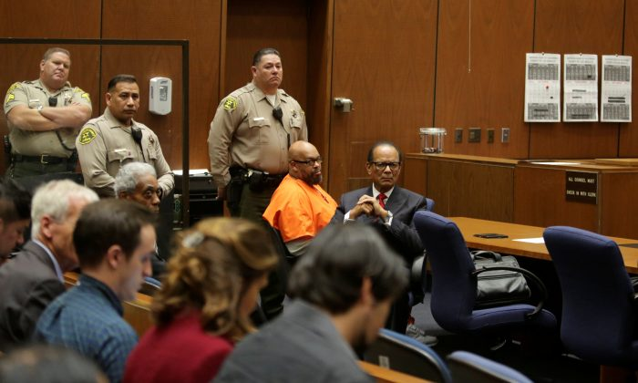 "Former rap mogul Marion ""Suge"" Knight with attorney Albert DeBlanc, appears in court to formally receive his 28-year prison sentence for a manslaughter conviction in the fatal 2015 hit-and-run killing of a man he ran down with his pickup truck in Los Angeles on Oct. 4, 2018.    David McNew/EPA/Pool via REUTERS"