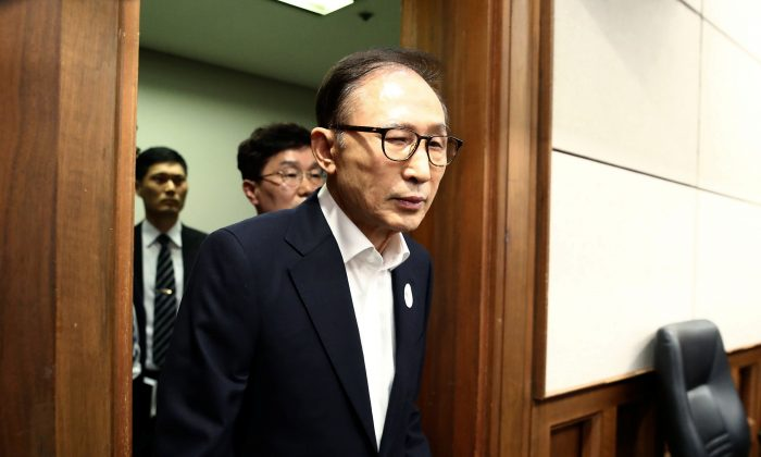 Former South Korean President Lee Myung-Bak appears for his first trial at the Seoul Central District Court on May 23, 2018 in Seoul, South Korea. (Chung Sung-Jun/Pool/Reuters)