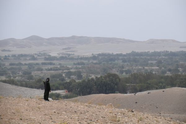 A member of an armed pro-government uprising group overlooks Taliban-held areas just outside ofKaga, Afghanistan.