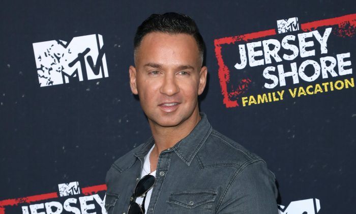 "Mike ""The Situation"" Sorrentino arrives at the ""Jersey Shore Family Vacation"" premiere in Los Angeles on March 29, 2018. (Willy Sanjuan/Invision/AP)"