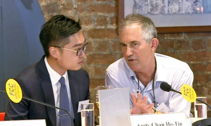 The Financial Times Asia news editor, Victor Mallet (right) speaks with Andy Chan, founder of the Hong Kong National Party, during a luncheon at the Foreign Correspondents Club in Hong Kong on Aug. 14, 2018. (AP)