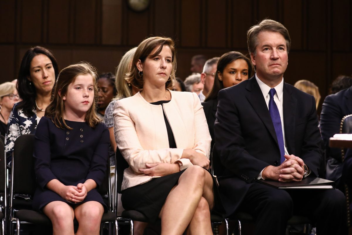 kavanaugh at a hearing with his wife and daughter