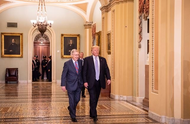 Then President Donald Trump and then Senate Majority Leader Mitch McConnell arrive for the Senate Republican policy lunch at the U.S. Capitol in Washington on May 15, 2018. (Samira Bouaou/The Epoch Times)