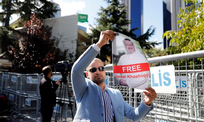 A demonstrator holds a picture of Saudi journalist Jamal Khashoggi during a protest in front of Saudi Arabia's consulate in Istanbul, Turkey, on Oct. 5, 2018. (Osman Orsal/Reuters)