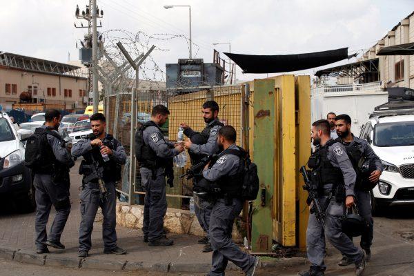 Israeli policemen patrol scene