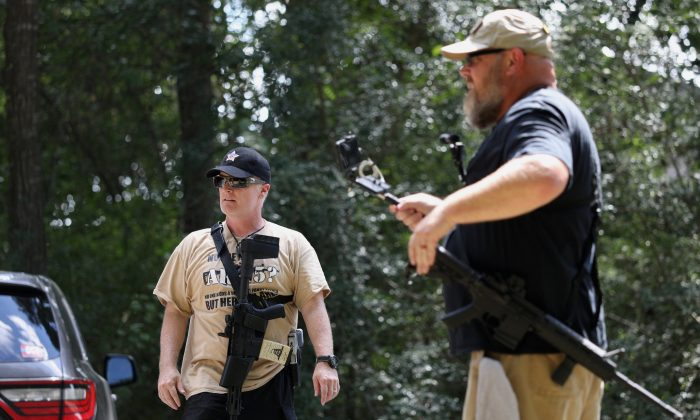 C.J. Grisham (L), founder of Open Carry Texas, and Greg Holland, a member of Open Carry Texas, in Houston, Tex., on Sept. 24, 2018. (Reuters/Loren Elliott)