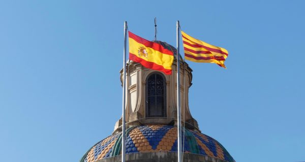 The Catalan and Spanish flags on Palau de la Generalitat.