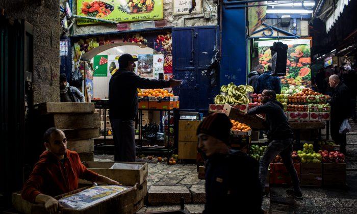 People work in a fruit market in Jerusalem, Israel, on Jan. 12, 2017.  (Chris McGrath/Getty Images)