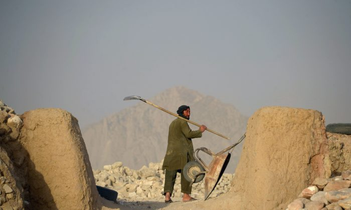 An Afghan labourer  on the outskirts of Mazar-i-Sharif. on June 20, 2018.  FARSHAD USYAN/AFP/Getty Images