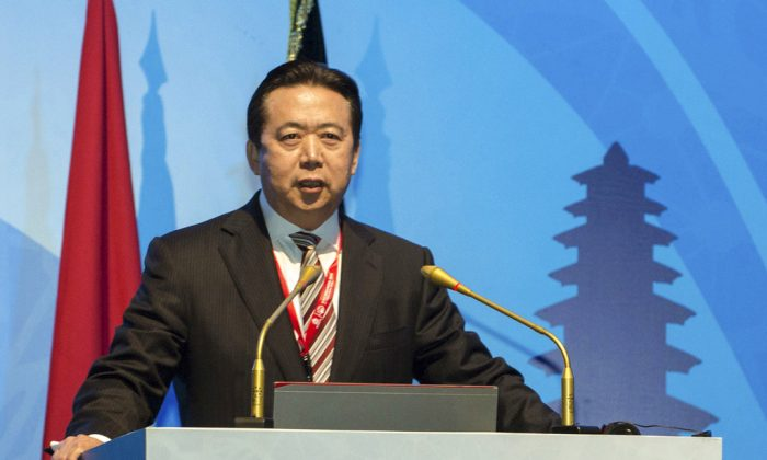 """Meng Hongwei delivers a campaign speech at the 85th session of the general assembly of the International Criminal Police Organization (Interpol), in Bali, Indonesia on Nov. 10, 2016. (Du Yu/Xinhua via AP)In a statement posted on a government website Monday, Oct. 8, 2018, the authorities said Meng Hongwei, China's vice minister for public security, was being investigated due to his own """"willfulness and for bringing trouble upon himself."""" (Du Yu/Xinhua via AP, File)"""