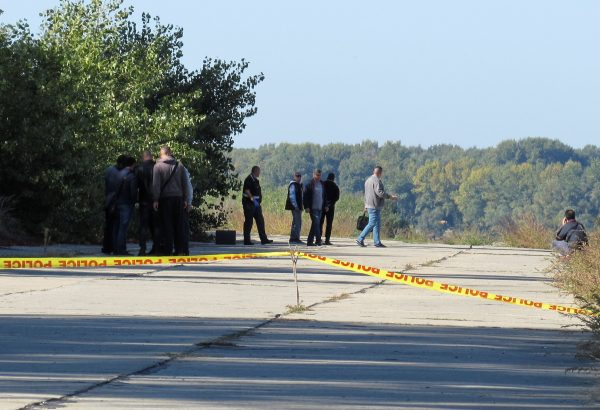 Police investigators walk near a crime scene where TV journalist Viktoria Marinova was murdered