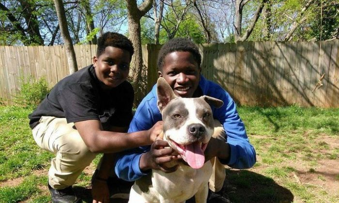 Two boys working with a nonprofit organization to care for unwanted pets in the Peoplestown neighborhood of Atlanta. (Courtesy of W-Underdogs Inc.).