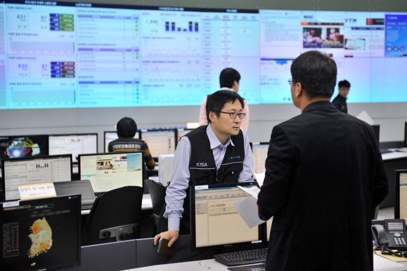Members of the Korea Internet Security Agency check on cyber attacks at a briefing room in Seoul on March 20, 2013. (Jung Yeon-Je/AFP/Getty Images)