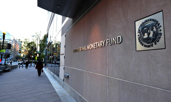 The International Monetary Fund (IMF) building sign is viewed in Washington, DC on April 5, 2016. (Karen Bleier/AFP/Getty Images)
