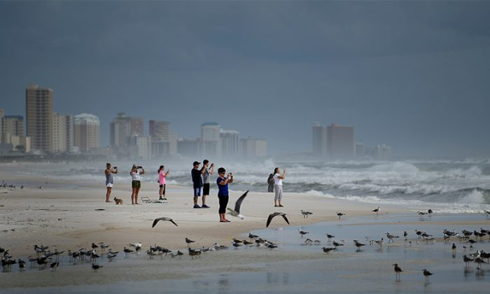 People look out to the Gulf of Mexico in Panama City Beach, Florida as Hurricane Michael approaches Oct. 9, 2018 (Brendan Smialowski/AFP/Getty Images)