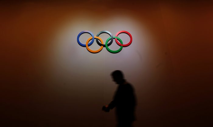 A man walks past the Olympic Rings as he walks out of the 133rd International Olympic Committee (IOC) session in Buenos Aires, Argentina, on Oct. 8, 2018. (Marcos Brindicci/Reuters)